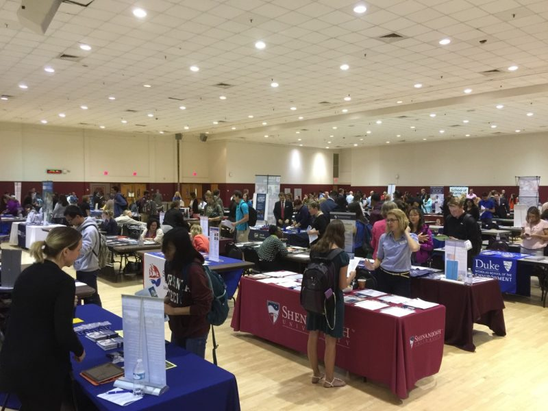 Students visiting tables at the Graduate and Professional School Fair in the Commonwealth Ballroom