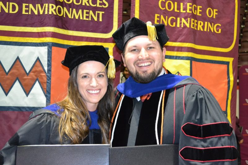 Amy and Gary Nave hold their diplomas after receiving them at the Graduate School Fall 2018 Commencement Ceremony