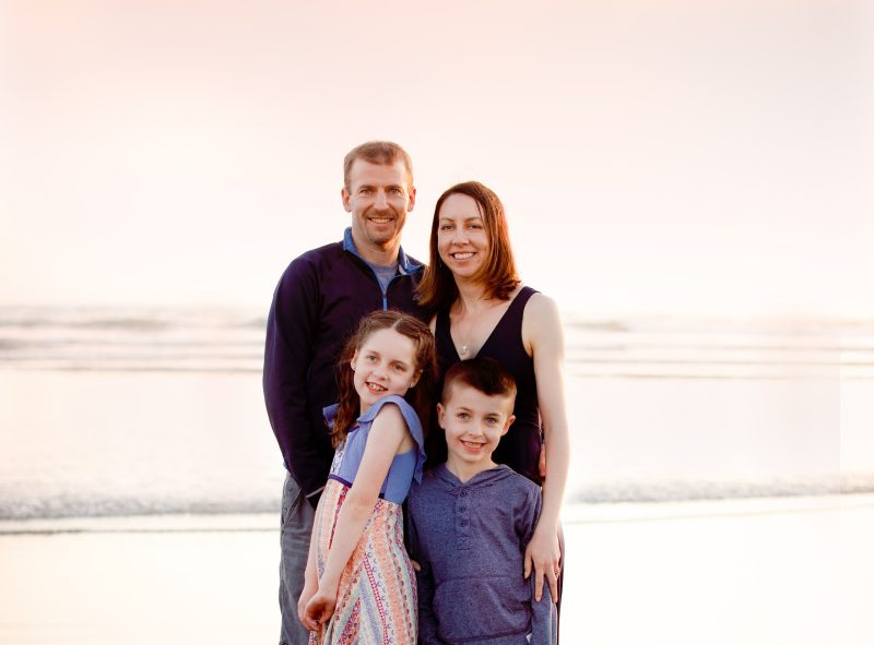 Tom Gorman and Jessica Homyack with their children, Violet and Leo on the beach at sunset