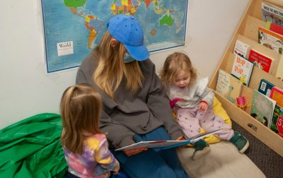 photo of dad giving daughter a balloon on the patio of the GLC