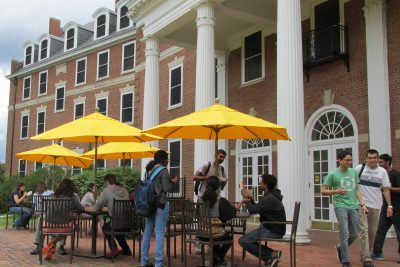 Students gather at the Graduate Life Center patio tables