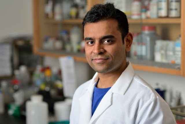 Ph.D. student Sid Roy in the lab.